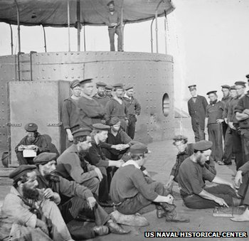 Crewmen relaxing on deck, while the ship was in the James River, Virginia, on 9 July 1862