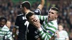 Celtic striker Gary Hooper (right) tussles with Stephan Lichsteiner 