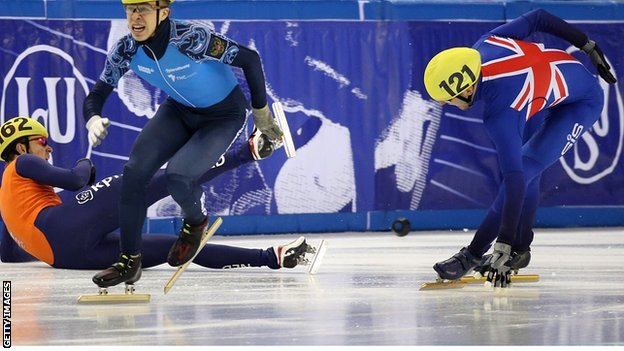 Jon Eley (right) in action during the 500m speed skating semi-final in Hungary