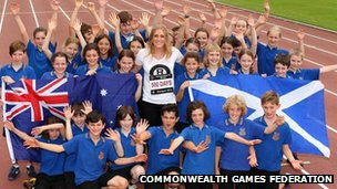 Hurdler Sally Pearson celebrates with school children in Sydney, Australia