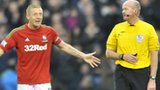 Swansea's Garry Monk argues with referee Lee Mason