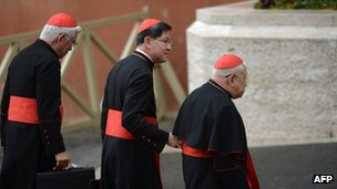 Philippines cardinal Luis Antonio Taggle (C) arrives with other cardinals for a meeting of pre-conclave on March 9