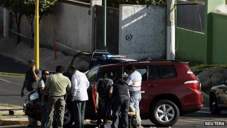 Investigators at the scene of the killing of Jalisco state&#039;s tourism minister