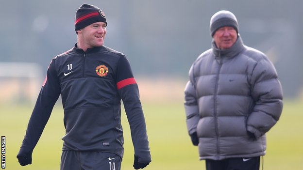 Manchester United striker Wayne Rooney and manager Sir Alex Ferguson