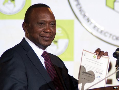 Uhuru Kenyatta shows a certificate confirming him as Kenya's new president in Nairobi, 9 March