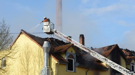 Firefighters extinguish the blaze in Backnang, 10 March