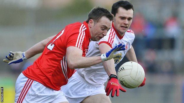 Cork's Paul Kerrigan in action against Ryan McKenna of Tyrone