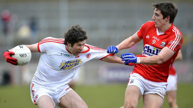 Tyrone midfielder Sean Cavanagh in action against Aidan Walsh of Cork