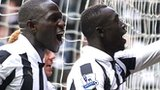Papiss Cisse (right) celebrates the winner for Newcastle against Stoke
