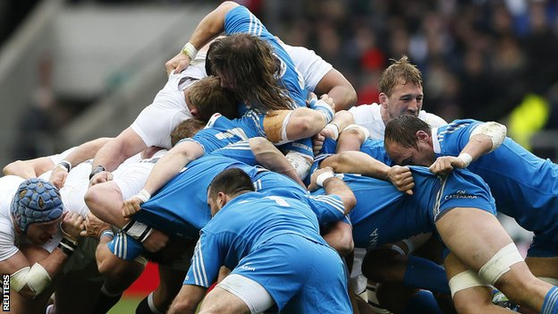 Typically brutal action as England (left) and Italy go hard in a scrum on Sunday