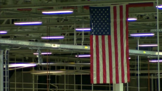 Stars and stripes hanging over factory floor