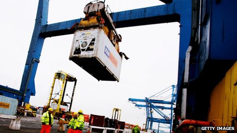 Ship freight containers are unloaded at the Tilbury Docks in Essex