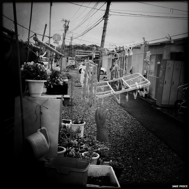 Rather than leave their land Tsukihama residents live in kasetsus (government provided temporary shelters). Boxy and small living there is depressing, but the residents continue on as best they can.