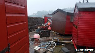 Damaged fishermen's huts at Rozel