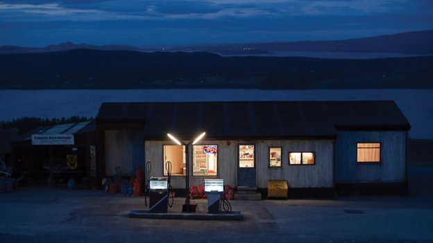 Petrol station lit up at night