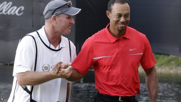 Tiger Woods (right) and caddie Joe Lacava