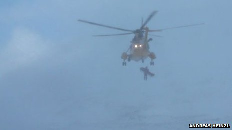 Helicopter airlifting fallen climber