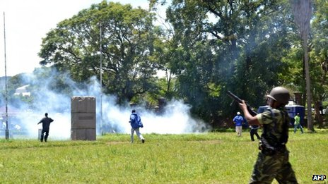 Police fire tear gas at supporters of Former Foreign affairs minister during a demonstration in Blantyre on March 11, 2013.