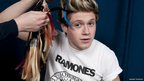 Niall from One Direction getting his hair colour matched up for this Madame Tussauds waxwork