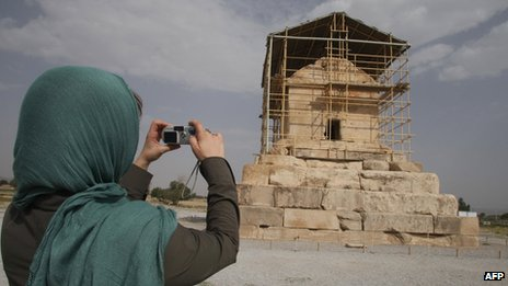 A visitor takes a picture of the limestone tomb of ancient Persia&#039;s King Cyrus the Great, in Pasargadae, 950km south of Tehran, Iran