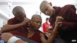 A Buddhist monk receives treatment at a hospital after police fired water cannon and gas during a pre-dawn crackdown on villagers and monks protesting against a Chinese-backed copper mine, in Monywa northern Myanmar on November 29, 2012.