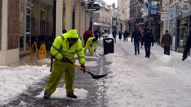 Workers clearing snow in King Street