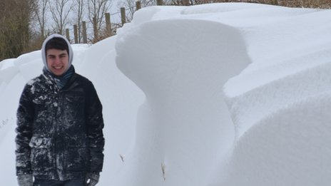 Daniel Mackay standing next to snow drift near Brabourne, Kent