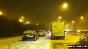 Cars in snow on A26