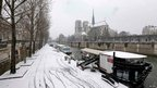 View of snow-covered banks along the River Seine near the Cathedral of Notre Dame de Paris (12 March 2013)