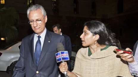 Italian Ambassador to India Daniele Mancini (left) leaves the Indian foreign ministry on 12 March 2013