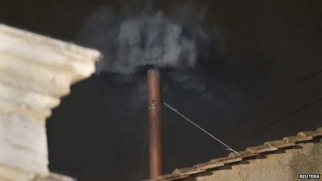 Black smoke rises from the chimney on the roof of the Sistine Chapel in Vatican City