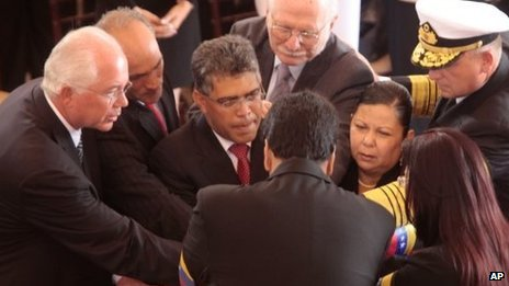 Venezuelan ministers around Hugo Chavez's coffin
