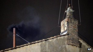 """Black smoke emerges from the chimney on the roof of the Sistine Chapel, in St. Peter""""s Square at the Vatican"""