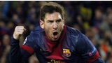 Barcelona forward Lionel Messi celebrates scoring against AC Milan