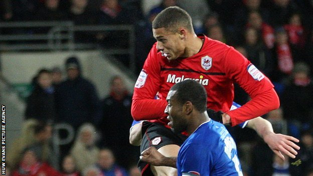 Rudy Gestede heads home Cardiff City's equaliser against Leicester City.