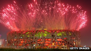 Fireworks explode over Bird's Nest during the Opening Ceremony of the 2008 Beijing Summer Olympics on 8 August 2008