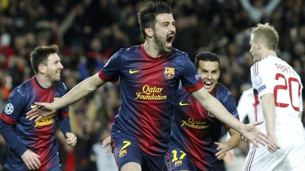 David Villa celebrates scoring for Barcelona against AC Milan