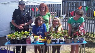 PCSO Pam Hayers helps with a plant sale to raise funds for the Happy Days Scheme