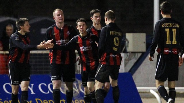 Crusaders players celebrate the penalty shoot-out victory over Lisburn Distilllery in the Irish Cup quarter-final replay