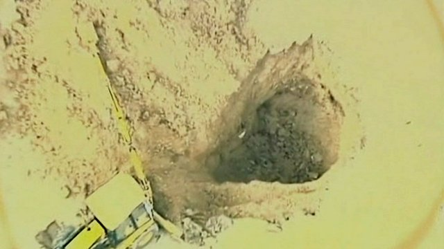 Digger filling in golf course sinkhole