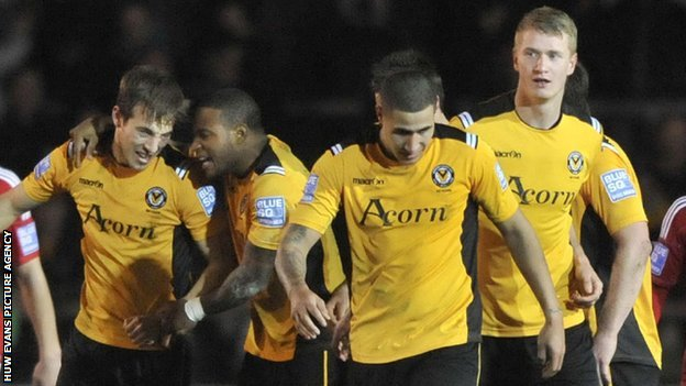 Newport County's players celebrate a goal