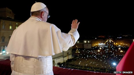 Pope Francis I greets the crowds from the balcony of St Peter's Basilica