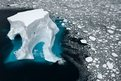 Southern Ocean, an iceberg floats in sea ice of the Ross Sea