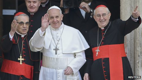 Pope Francis (centre) waves as he leaves after praying at basilica in Rome