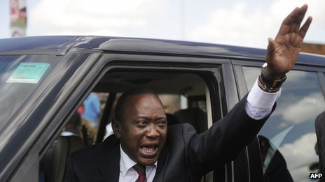 Uhuru Kenyatta waves to a crowd on 10 March 2013 in Nairobi