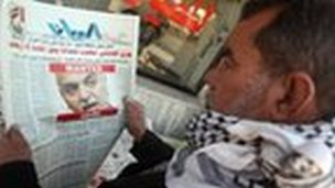 "An Iraqi man looks at a newspaper featuring a front page picture of Vice-President Tareq al-Hashemi with the word ""wanted"" above his face, on December 20, 2011."