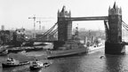 HMS Belfast takes up her moorings in the specially dredged berth in the Pool of London in 14 October 1971