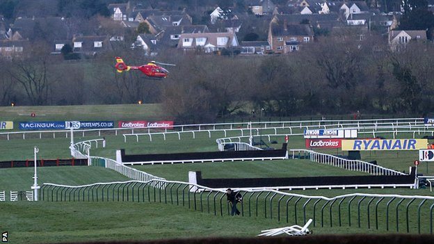 An air ambulance arrives at Cheltenham racecourse for jockey JT McNamara