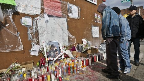 "People visit a growing makeshift memorial for police shooting victim Kimani ""Kiki"" Gray on 14 March 2013  in East Flatbush"