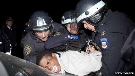 A man is arrested at a protest against the shooting of Kimani Gray 13 March 2013